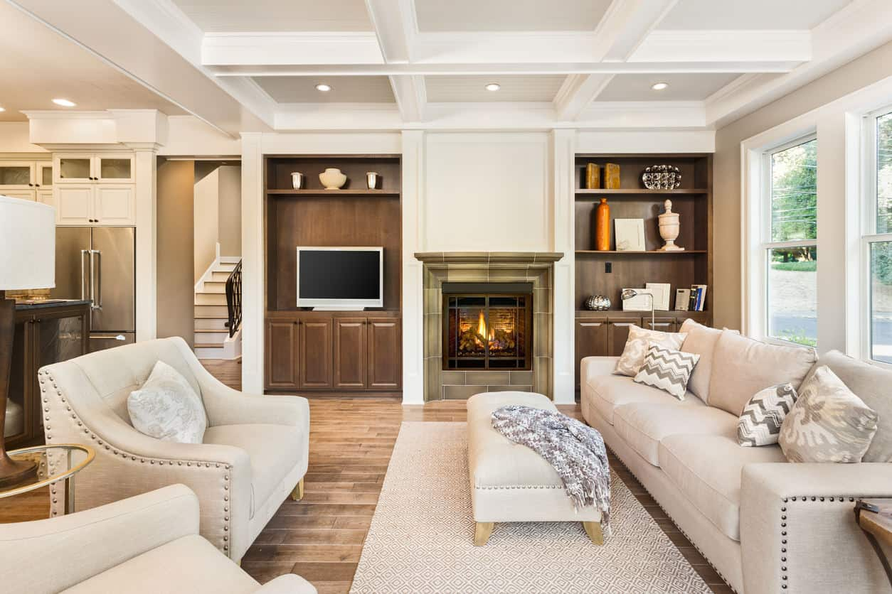A contemporary living room with rustic touches, this room has distressed cool toned light hardwood and matching furniture with warmer accents throughout the room.