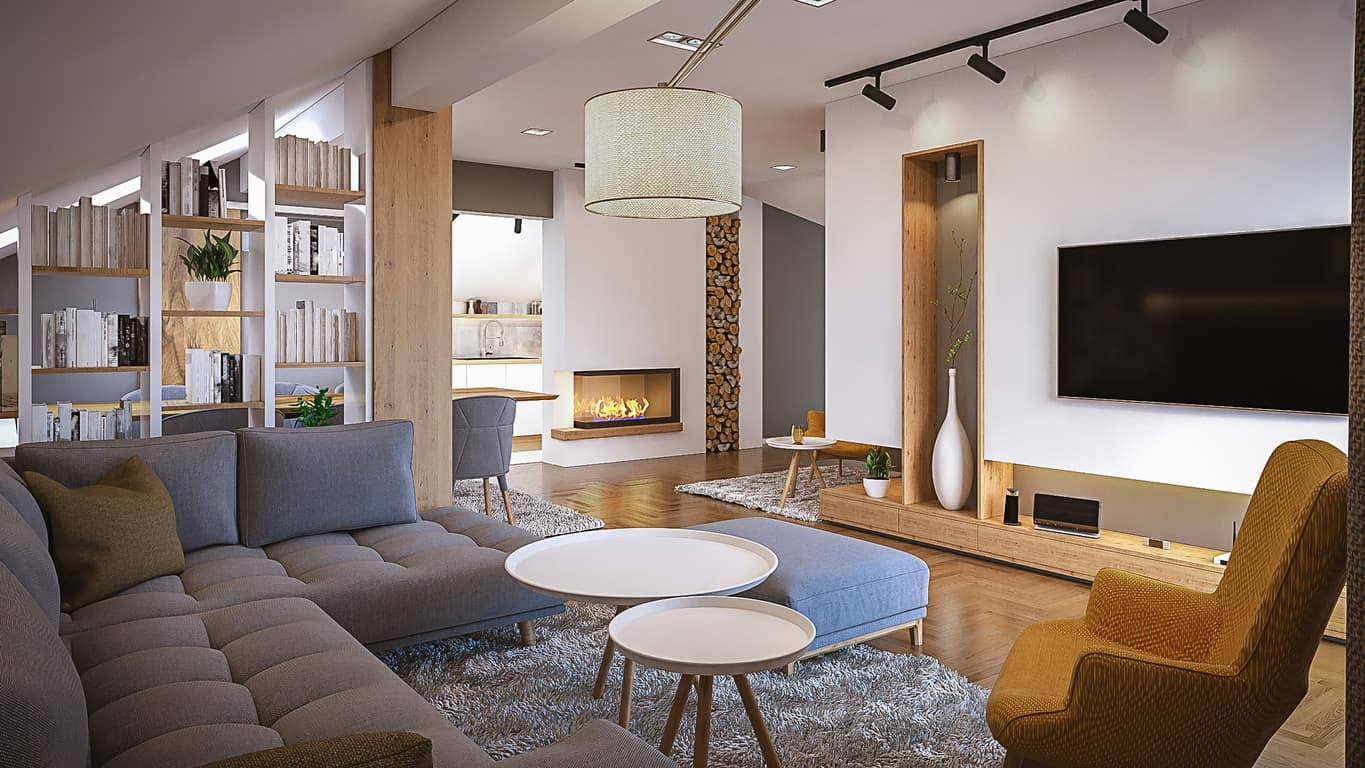 This living room is small but the cool toned light hardwood floors and matching furniture make it look spacious. The singular pop of color comes from the blue armchair.