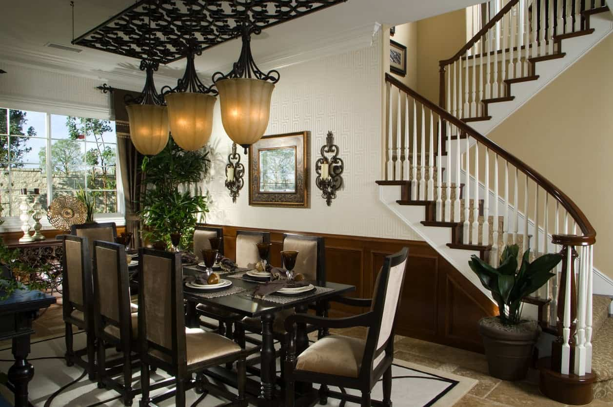 Luxury dining room with pendant lighting.