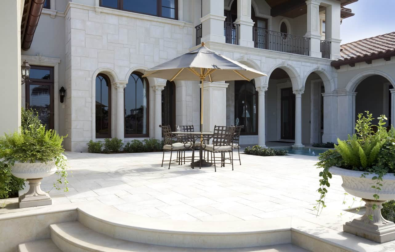 Luxury patio with patio furniture on flagstone flooring.