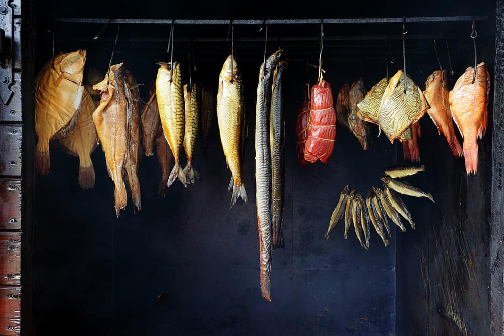 meat and fish getting smoked