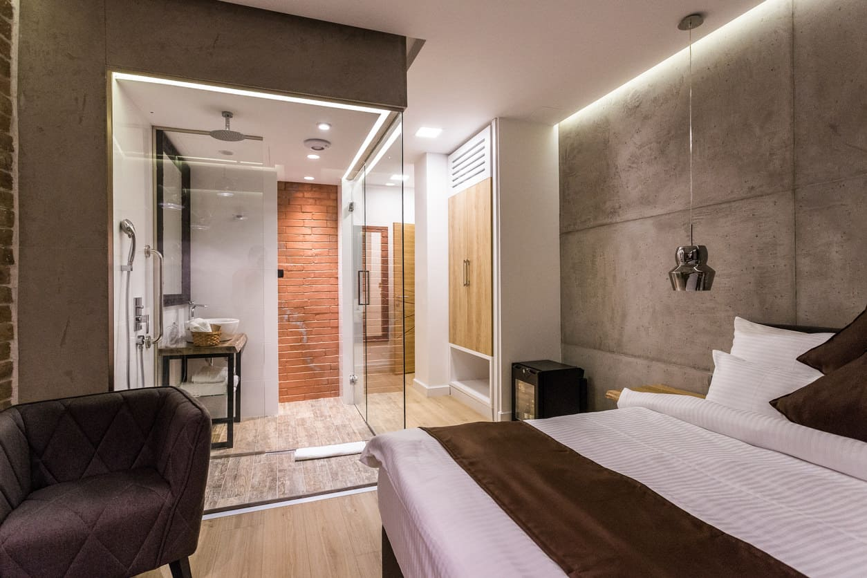 This is actually a hotel room but I included it (I rarely include hotel rooms in bedroom galleries) because it's very well done and it really could be a fabulous regular bedroom. However, you have to like the totally exposed walk-in-shower concept to like this bedroom.