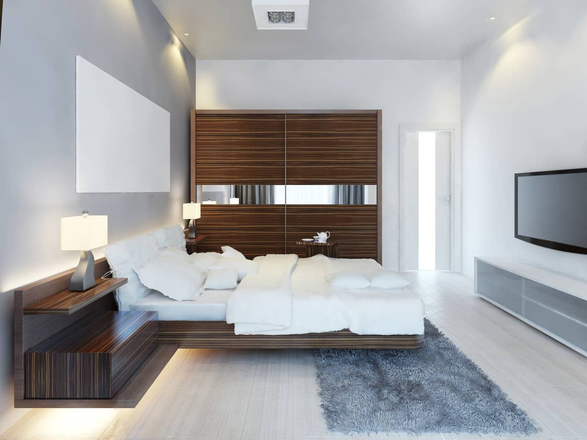 I love how the natural wood floor isn't totally concealed with the smaller area rug at the end of the bed. The dark wood juxtaposes nicely with the very light wood floor and white walls. Check out the lighting under the floating nightstands and bed.