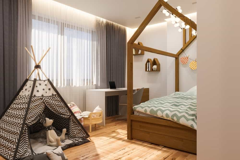 A modified kid's bedroom with a teepee tent.