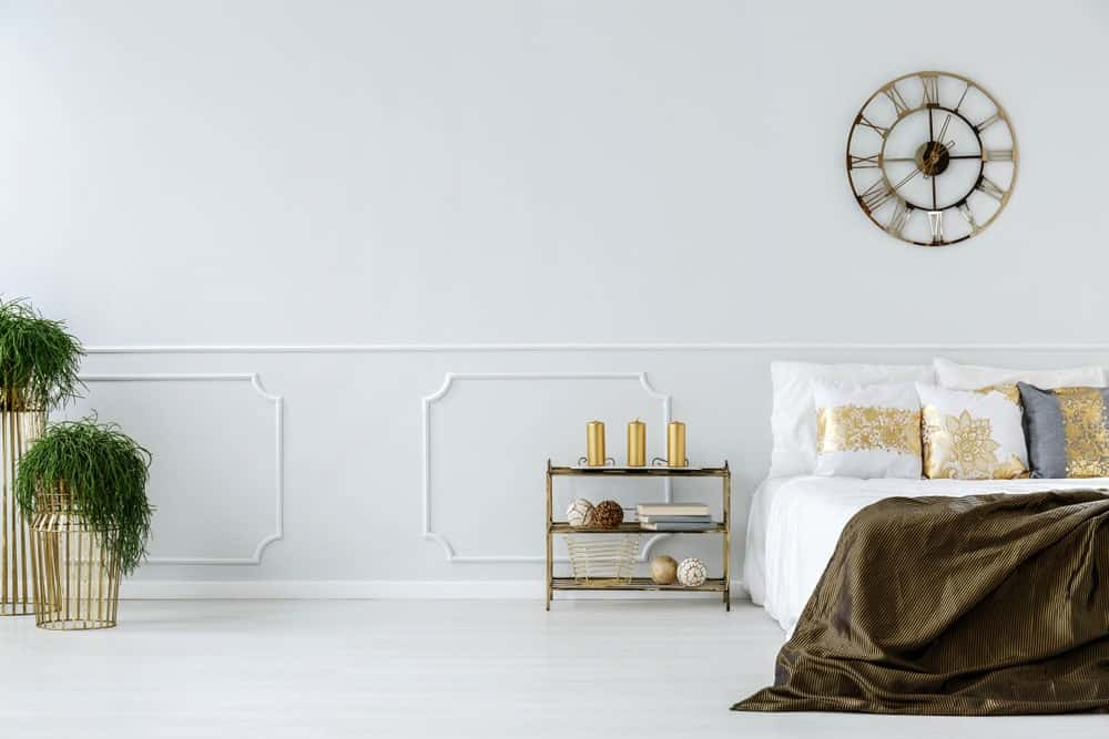 Decorative wall molding featured in this modern white bedroom.