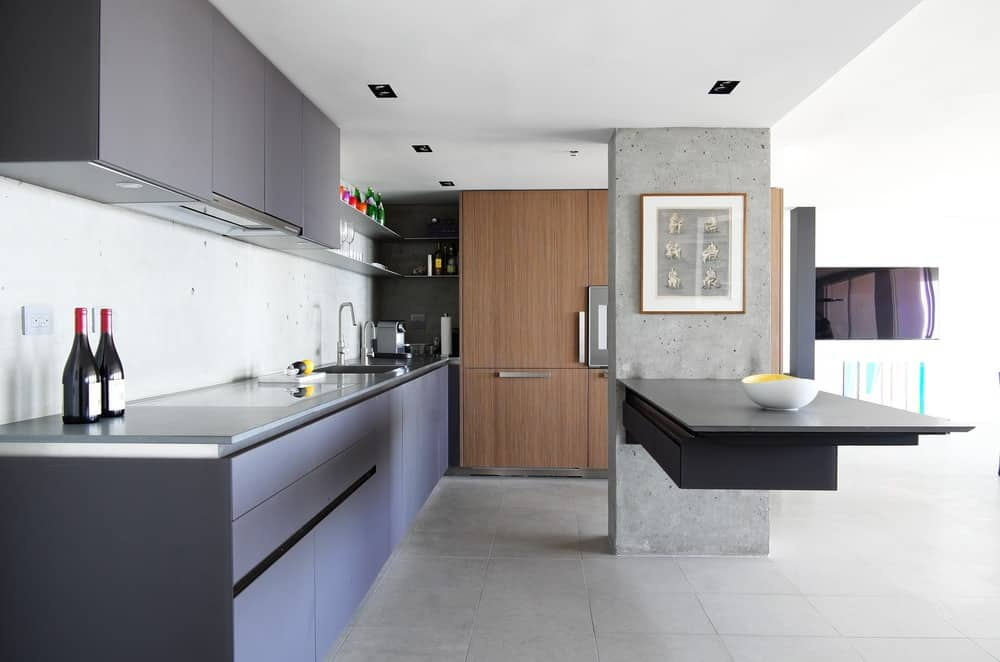 Modern kitchen with floating island in highrise condo