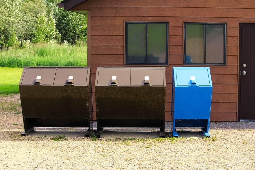 Bear proof garbage bins and recycling bin for home outdoor use.