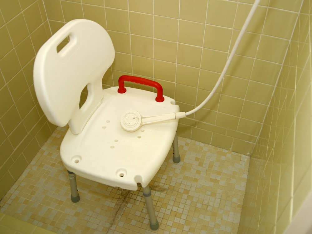 Shower chair in the shower room.