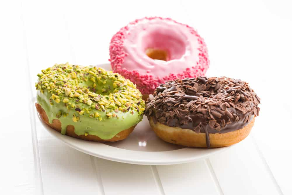 Colorful donuts on a white plate