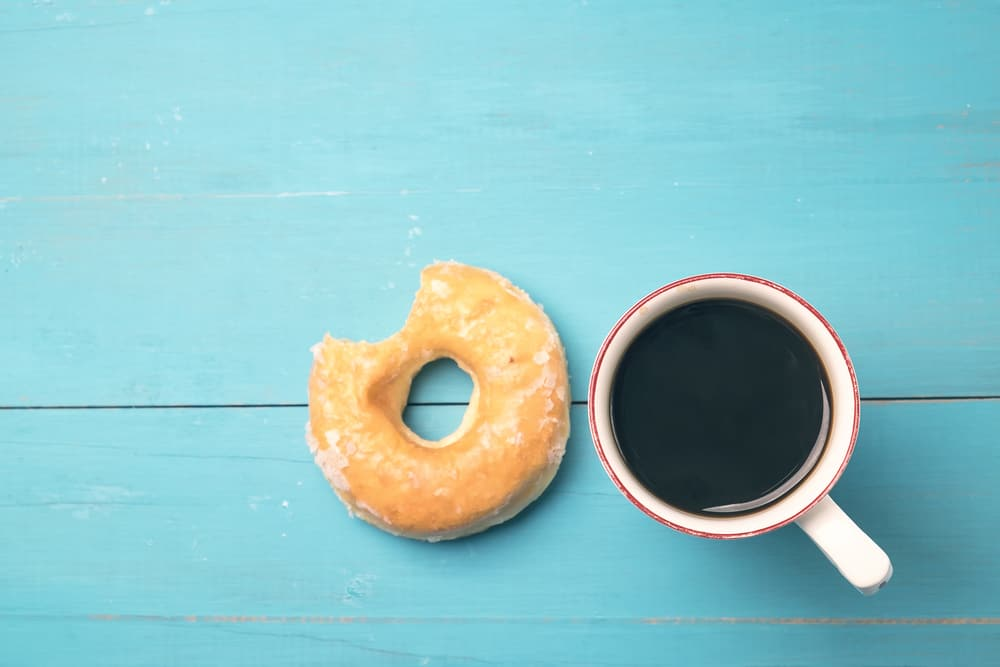 A cup of coffee and a donut