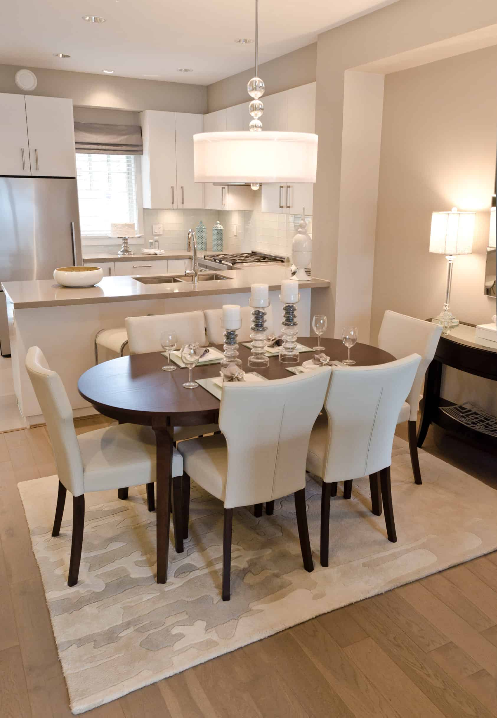 The soft pale tones are the characteristic of this dining room. The large white dining chairs look extremely soft and comfortable and surround a large oval wood table, which offers plenty of space for everyone in the family to eat comfortably. Several light fixtures and candlesticks provide plenty of bright light to the room. The room has an aura of grace and refinement.