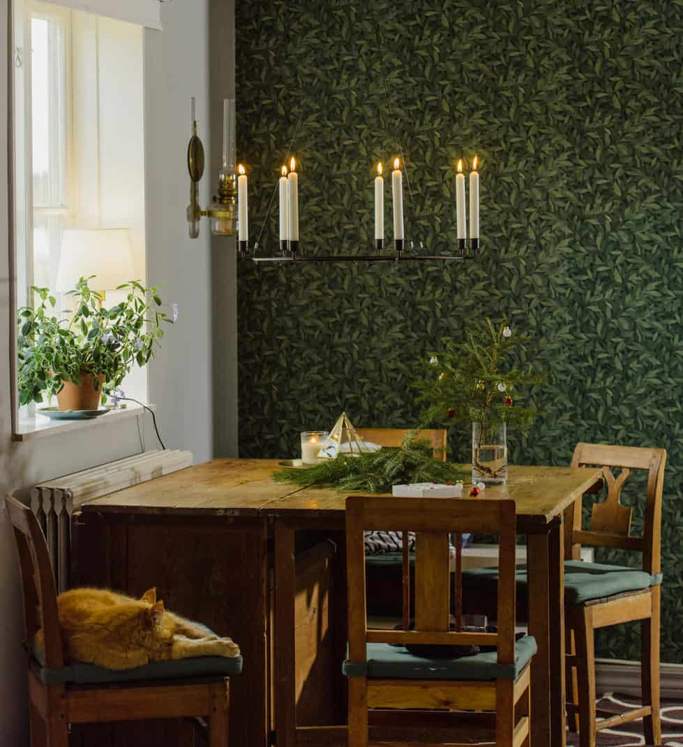 This Dining Room Looks Like It Has Sprung Within The Woodlands. The Dining  Table And Chairs Are Simple Wooden Affairs And A Candelabra With White  Tapers Is ...