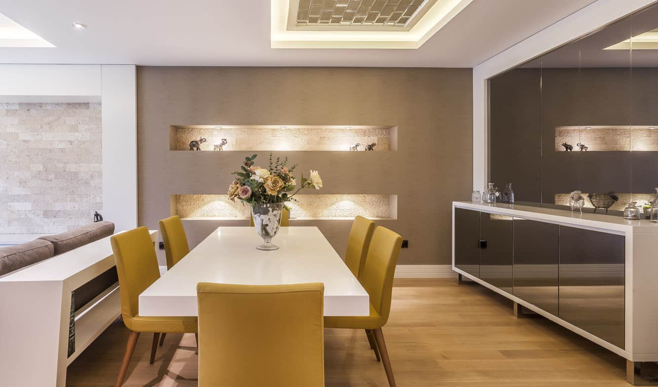When it comes to dining room designs, it seems gold is in these days. This particular dining room is almost all done in various shades of gold — but that doesn't mean it is overwhelmingly glitzy. In fact, the smooth white dining table and the white painted ceiling offset the gilt and keep things classy, cool and modern.