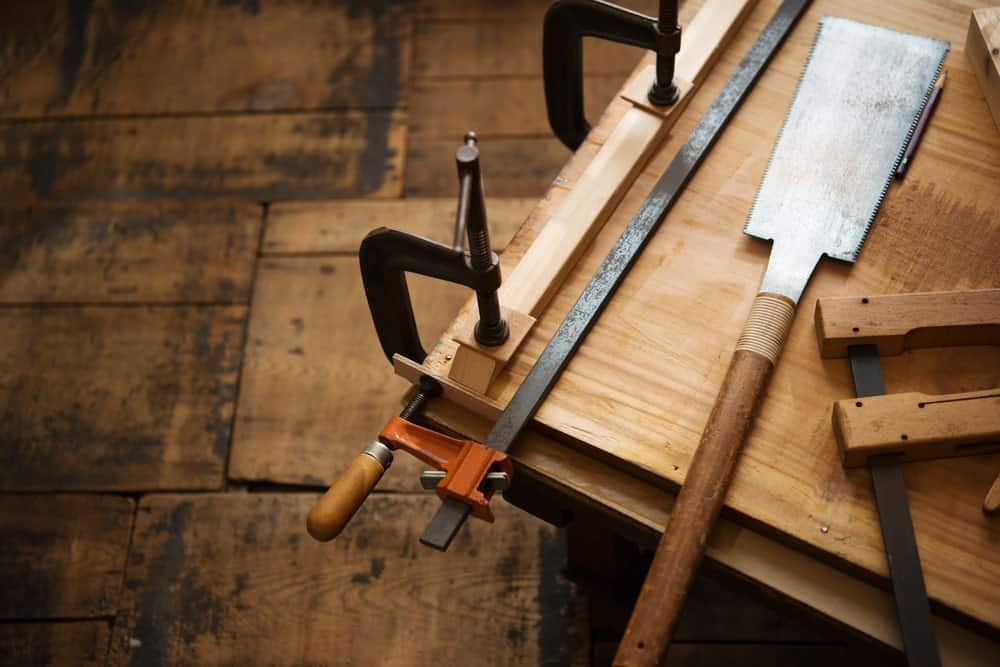 Cabinet making tools on a wooden board.