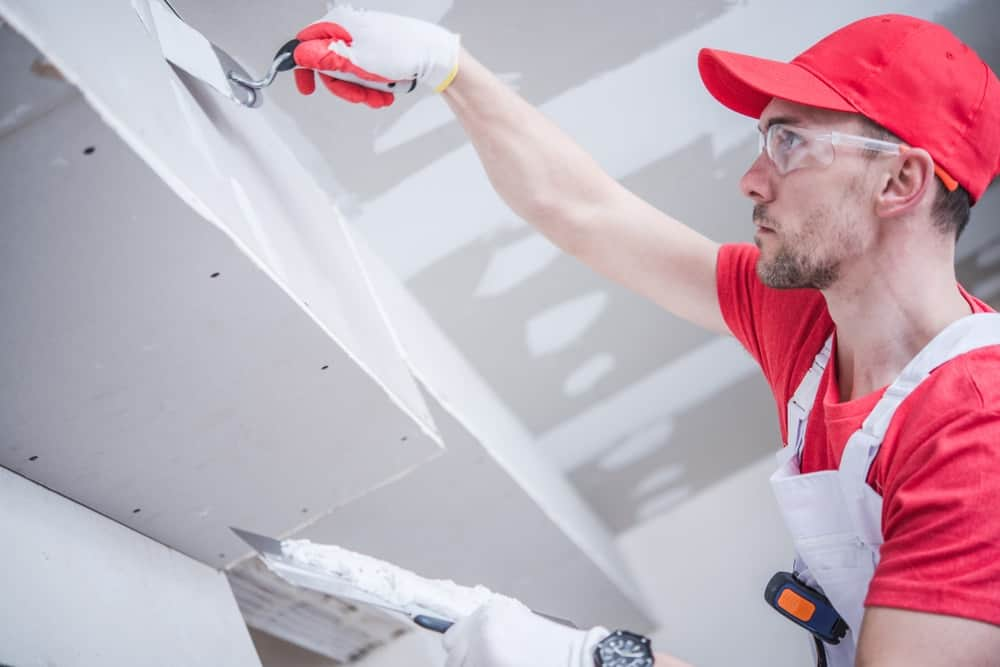 A person working on the drywall.