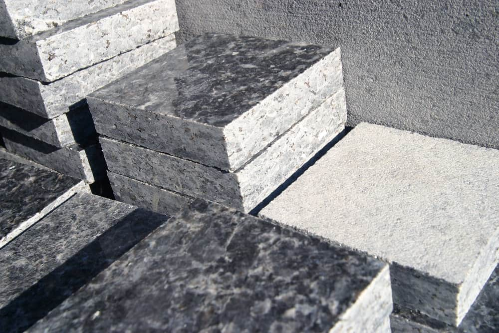 Stacks of thick square cut pieces of granite.