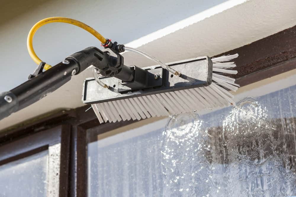 Washing a window pane with a window cleaning tool.