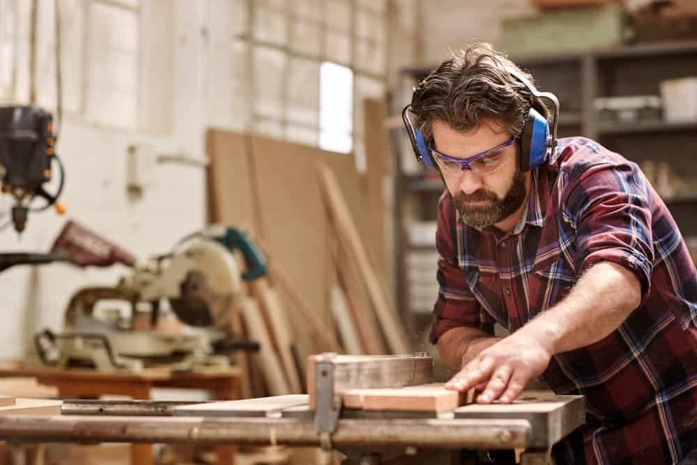 A woodworker at work in a woodworking shop.