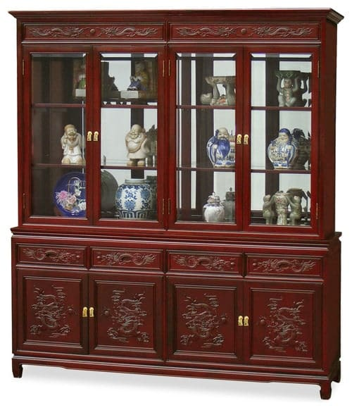 China cabinet with a mirrored back.