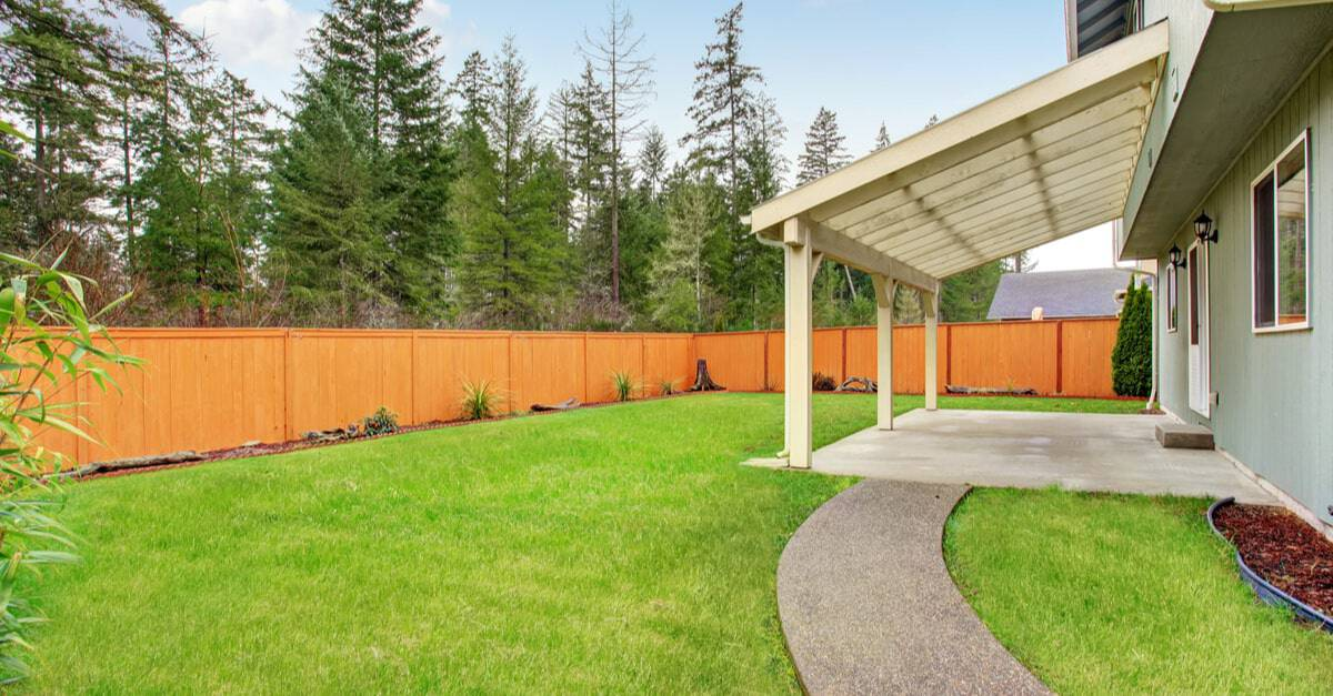 Backyard with a wooden privacy fence.