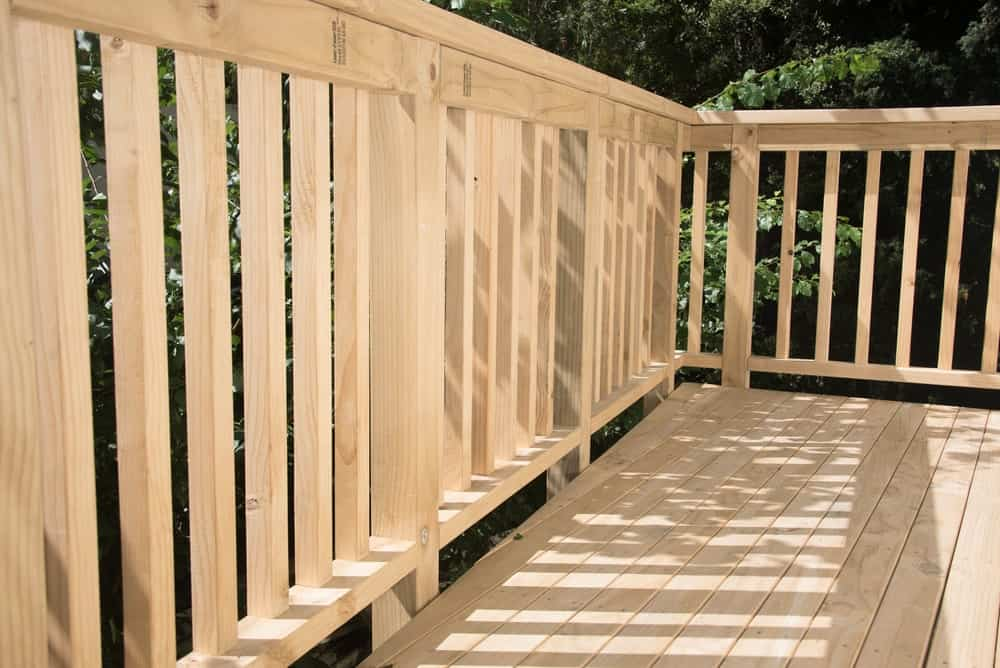 A deck or patio made from white pine timber