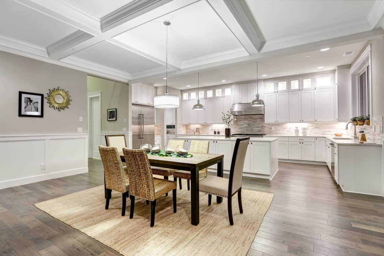 Eat-in kitchen with area rug on hardwood floor