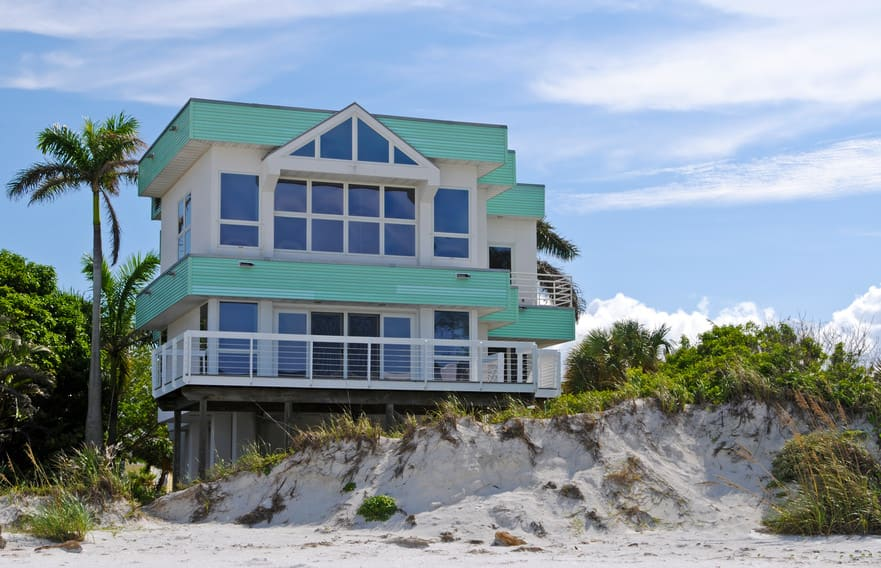 Super cool modern house built on sandy beach