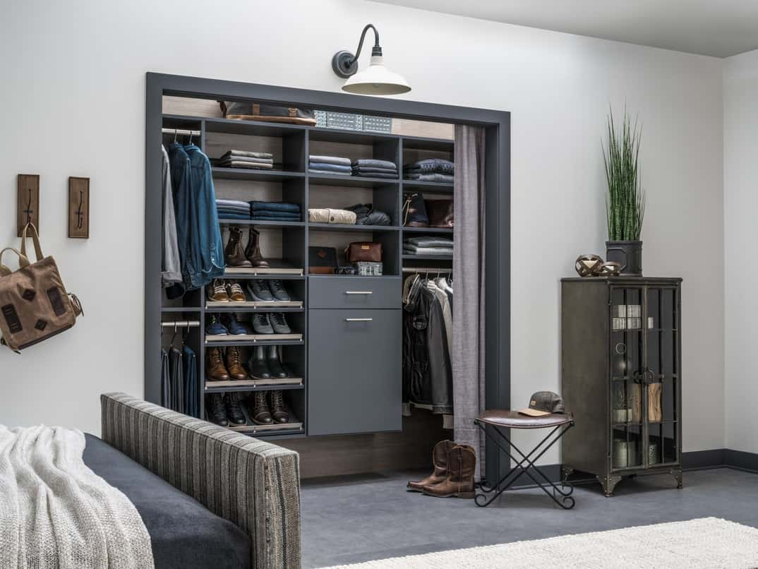 Very well designed custom reach-in closet with built closet organizer for shoes, shirts and small cabinet.