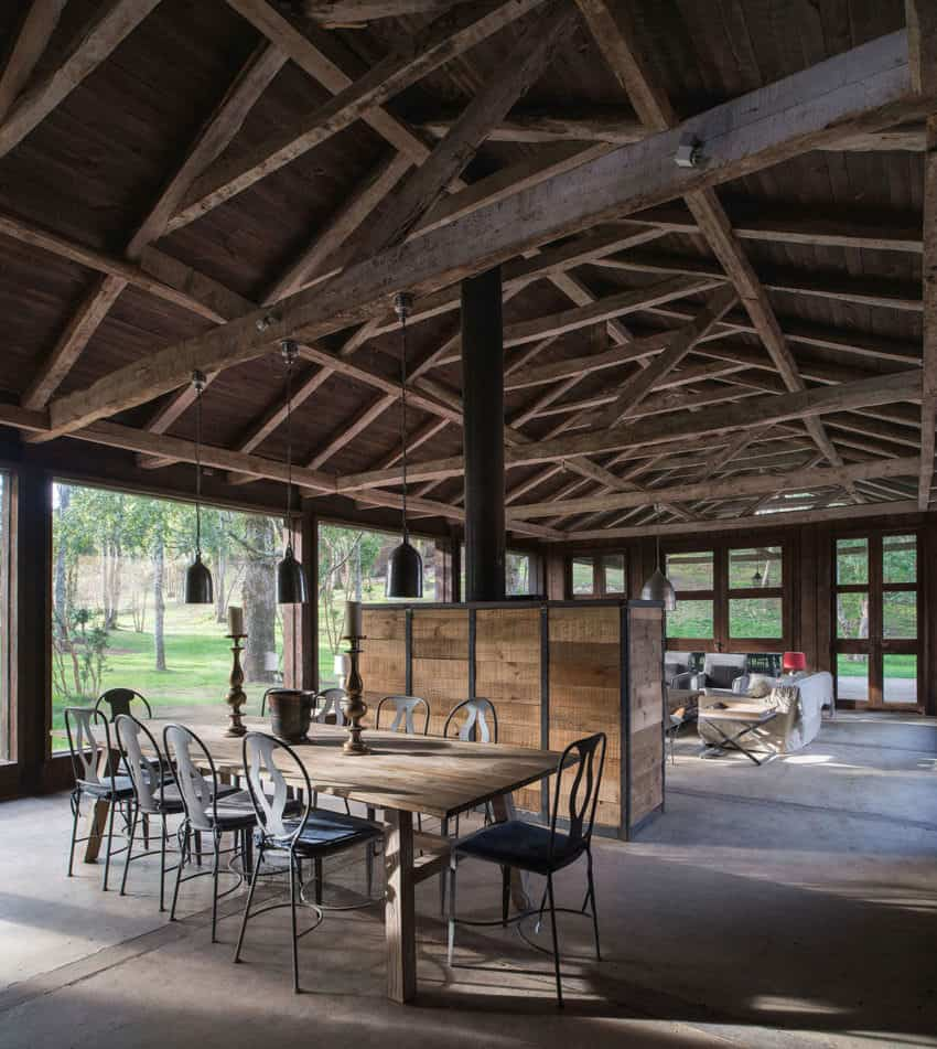 This rustic house is wider than it looks.  Notice all the space on each side running the entire length of the home.