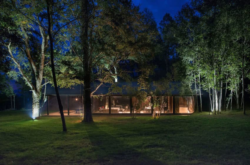 I love the park-like setting of this home. It's nestled in a slight dip surrounded by trees. The rustic design fits in perfectly.