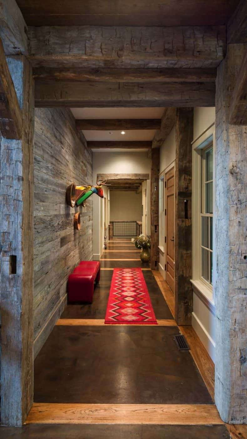 It's hard to get excited about a hallway in a house but the example here is truly exceptional.  Again, the red color scheme continues with a red bench in the red runner.   Designed by RTM Architects