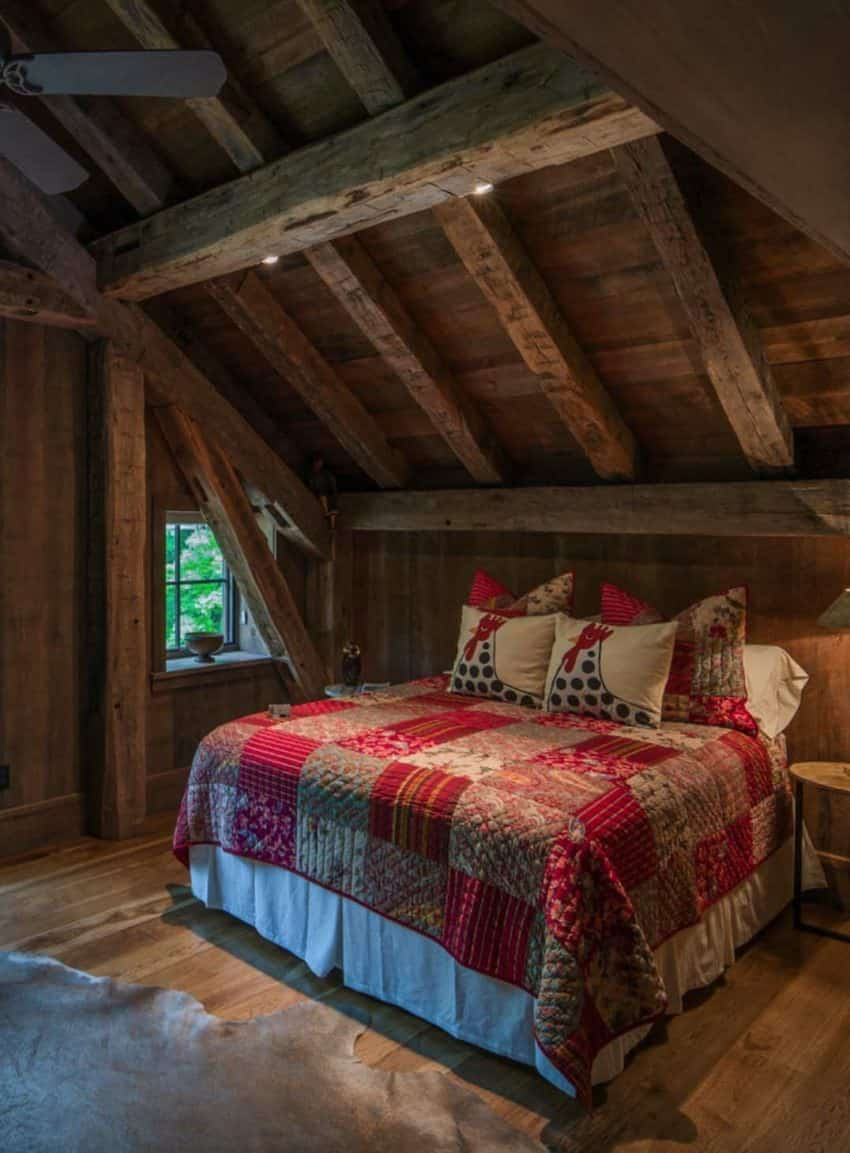 The rustic style is just as prominent in the guest/kids rooms as the rest of the home.  The red quilt matches nicely with the rustic vibe.   Designed by RTM Architects