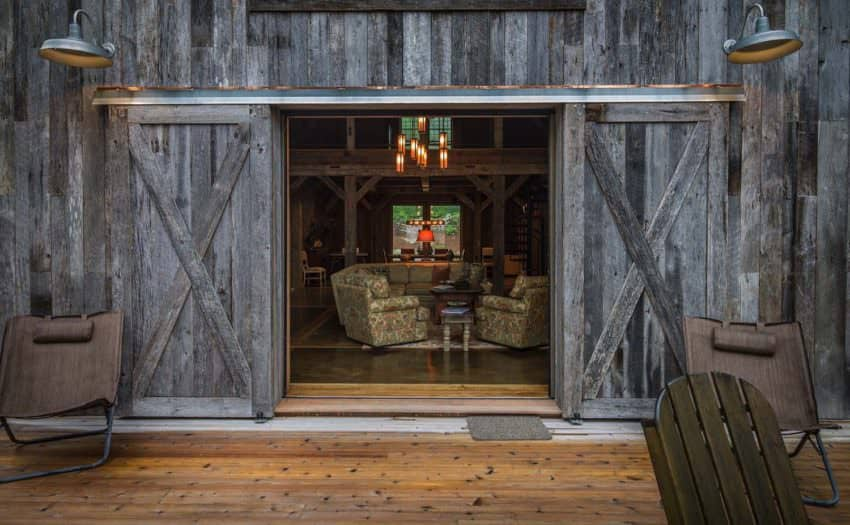 I like how one of the entrances preserved the old sliding barn doors, which are there for adornment. They look great. Designed by RTM Architects