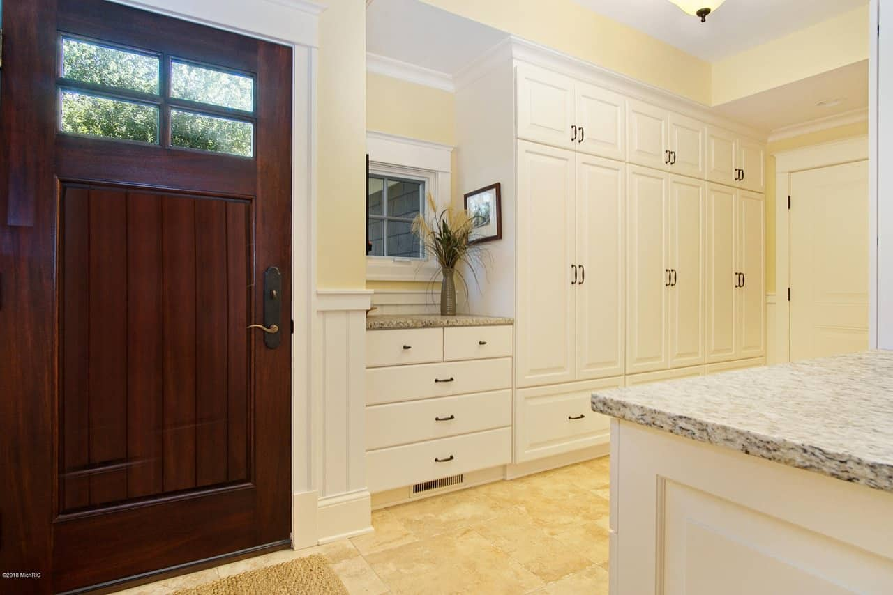 Large white mudroom in mansion beach house on Lake Michigan.