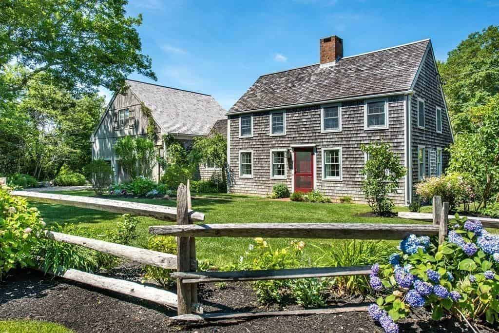 Colonial style house built in 1840 with wood shingle exterior and red front door