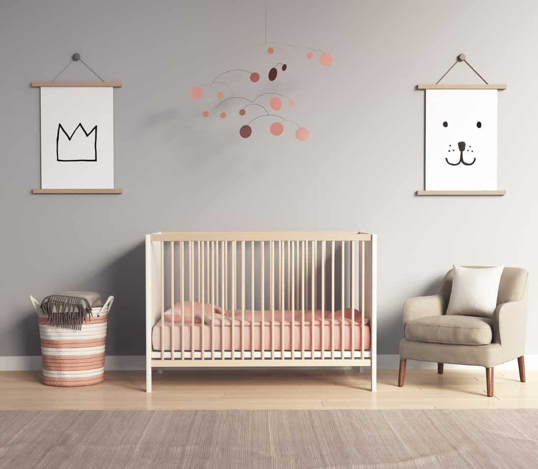 Simple but cute, this nursery room feature gray walls with cute designs on it. The crib has a minimal design while the rug perfectly fits with the flooring style.