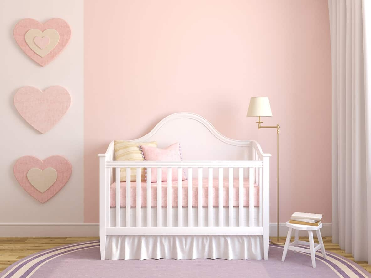 The mild color of pink and purple blended well with each other in this nursery room. The crib looks elegant along with the window curtains.