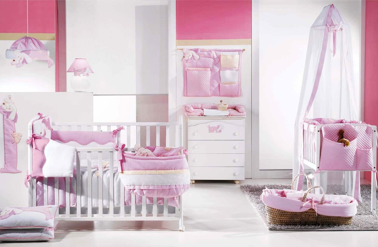 This nursery room offers a sweet touch of light and hard pink colors.  The white walls and furniture are just perfect with the pink finishes.