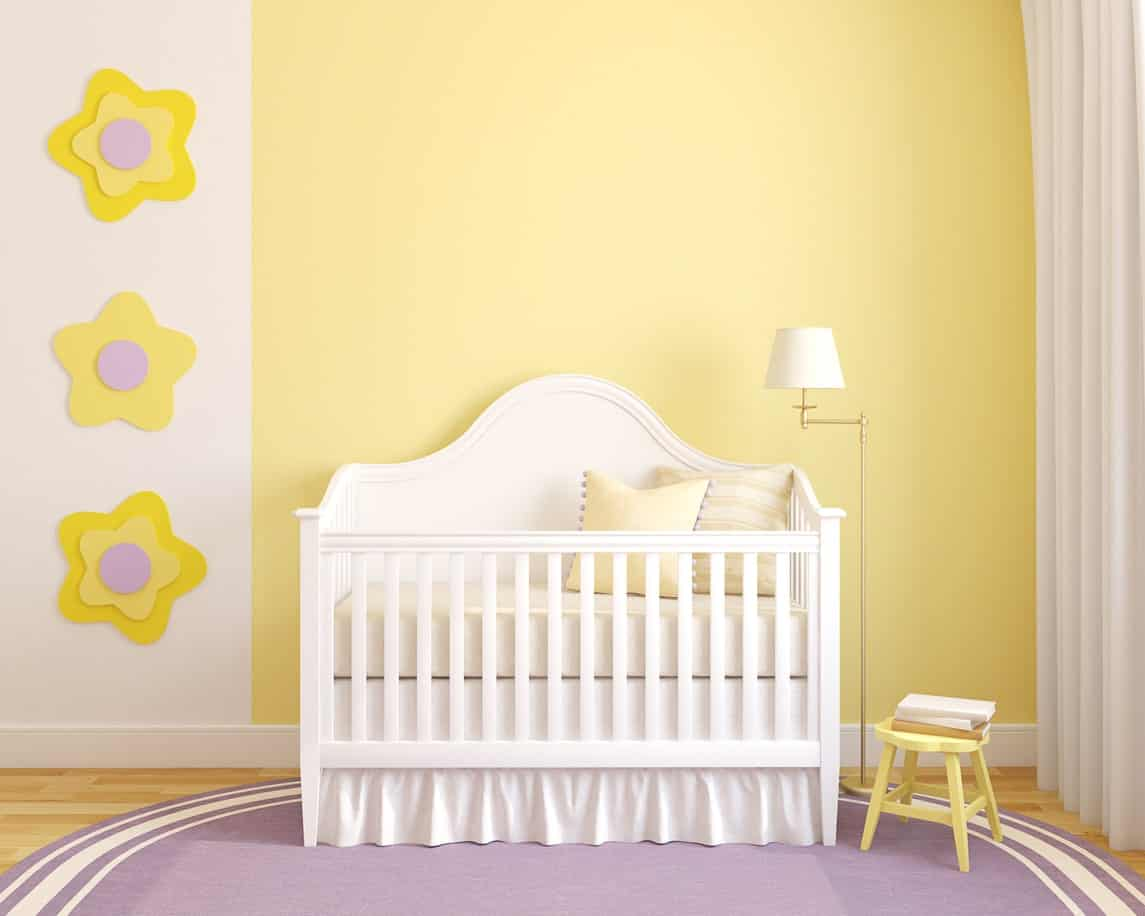 Bright colored nursery room featuring the combination of white, violet and yellow colors. The White curtains matches with the white crib.