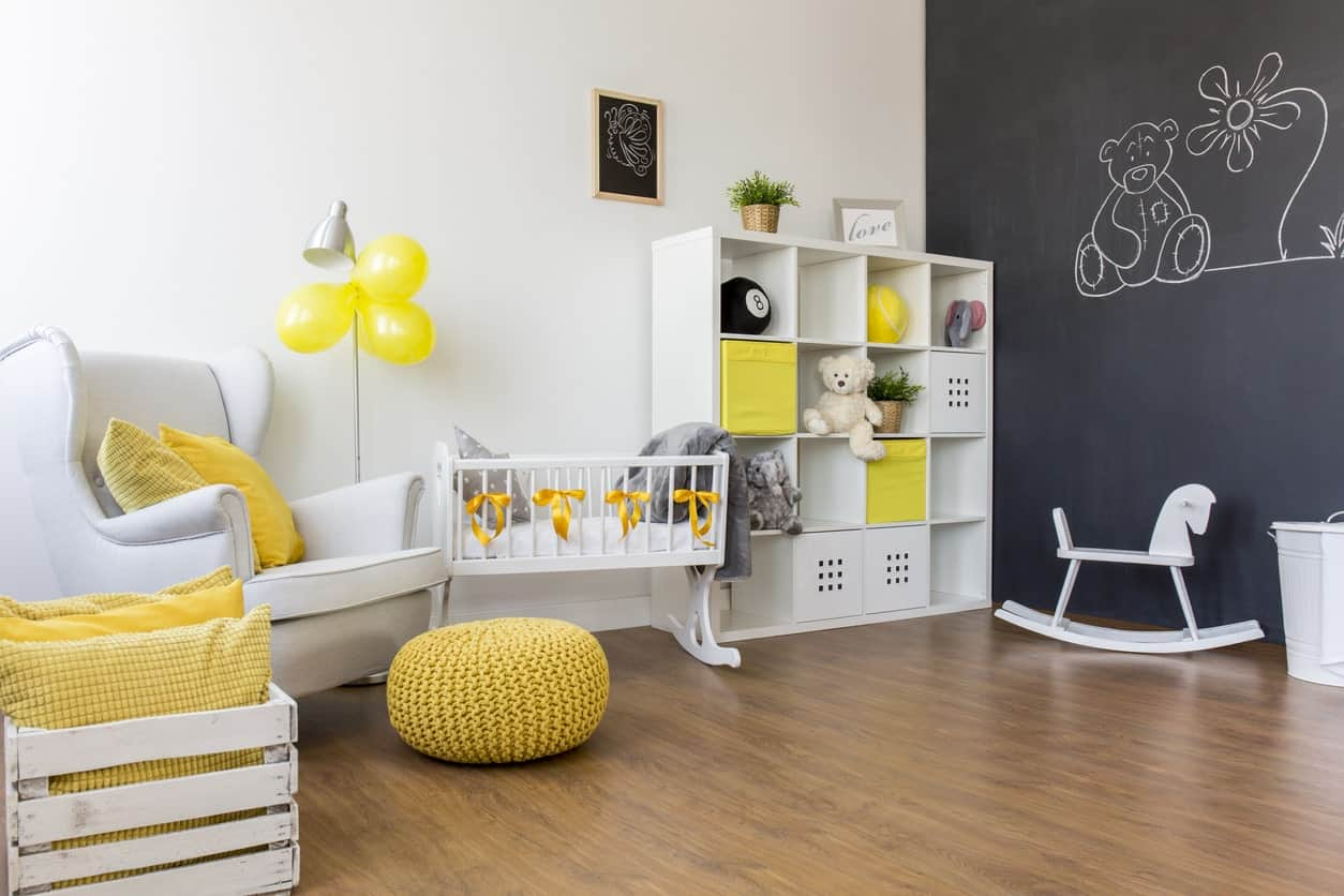 A blend of white, yellow and black is not bad at all. The white walls meeting the black with teddy design walls are just so cool and stylish. The vinyl flooring looks great as well.