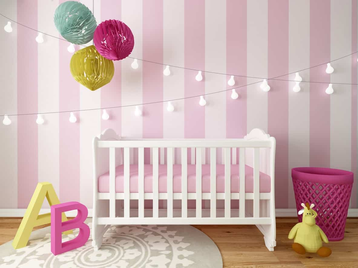 This pink, white and yellow color combination is perfect for a baby girl. The wall designs fits perfectly with the room's style and design.