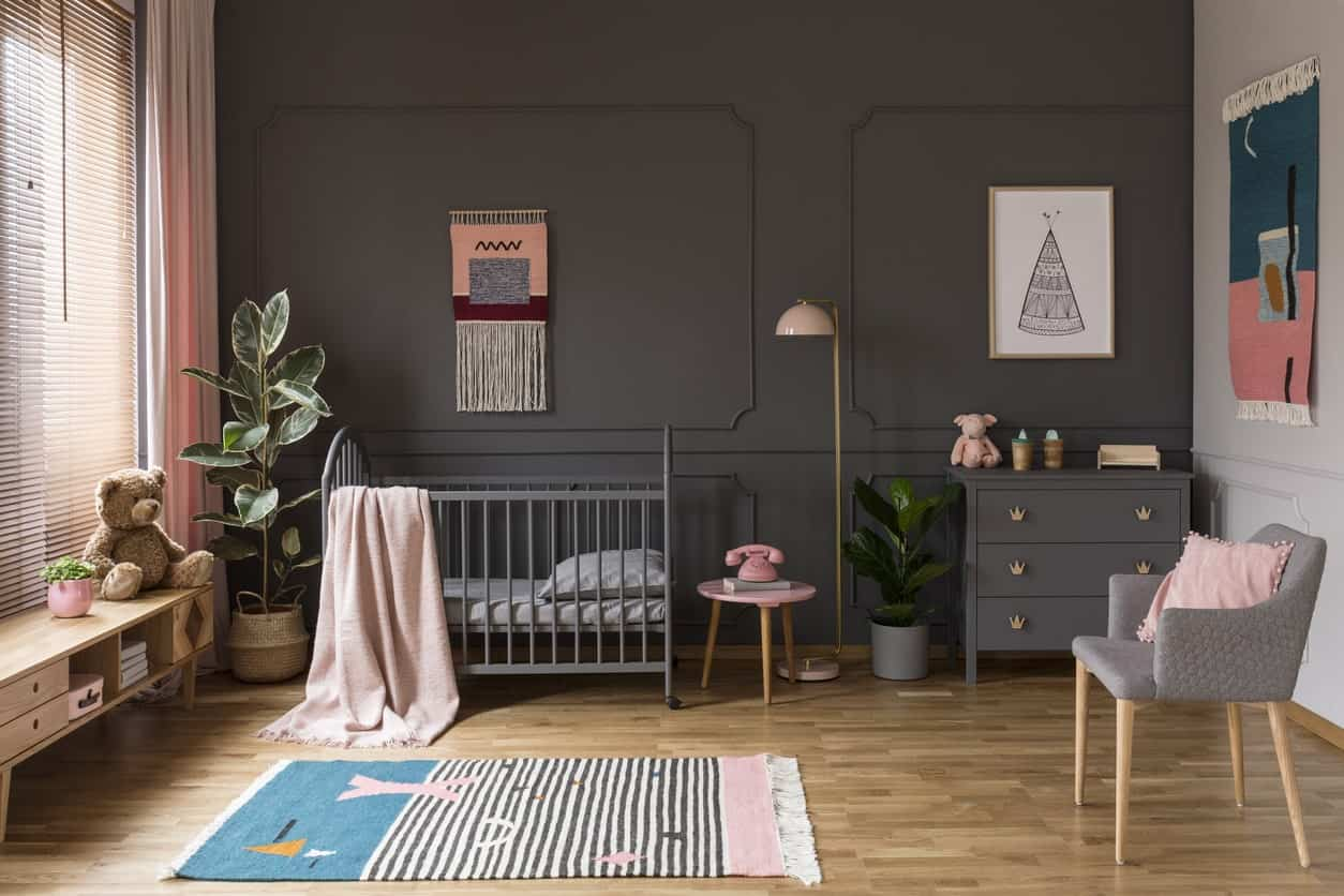 This nursery room is for a stylish and cool one. The gray finish on the walls and other furniture looks refreshing for the eyes while the wall decors and other room designs add colors to the space.