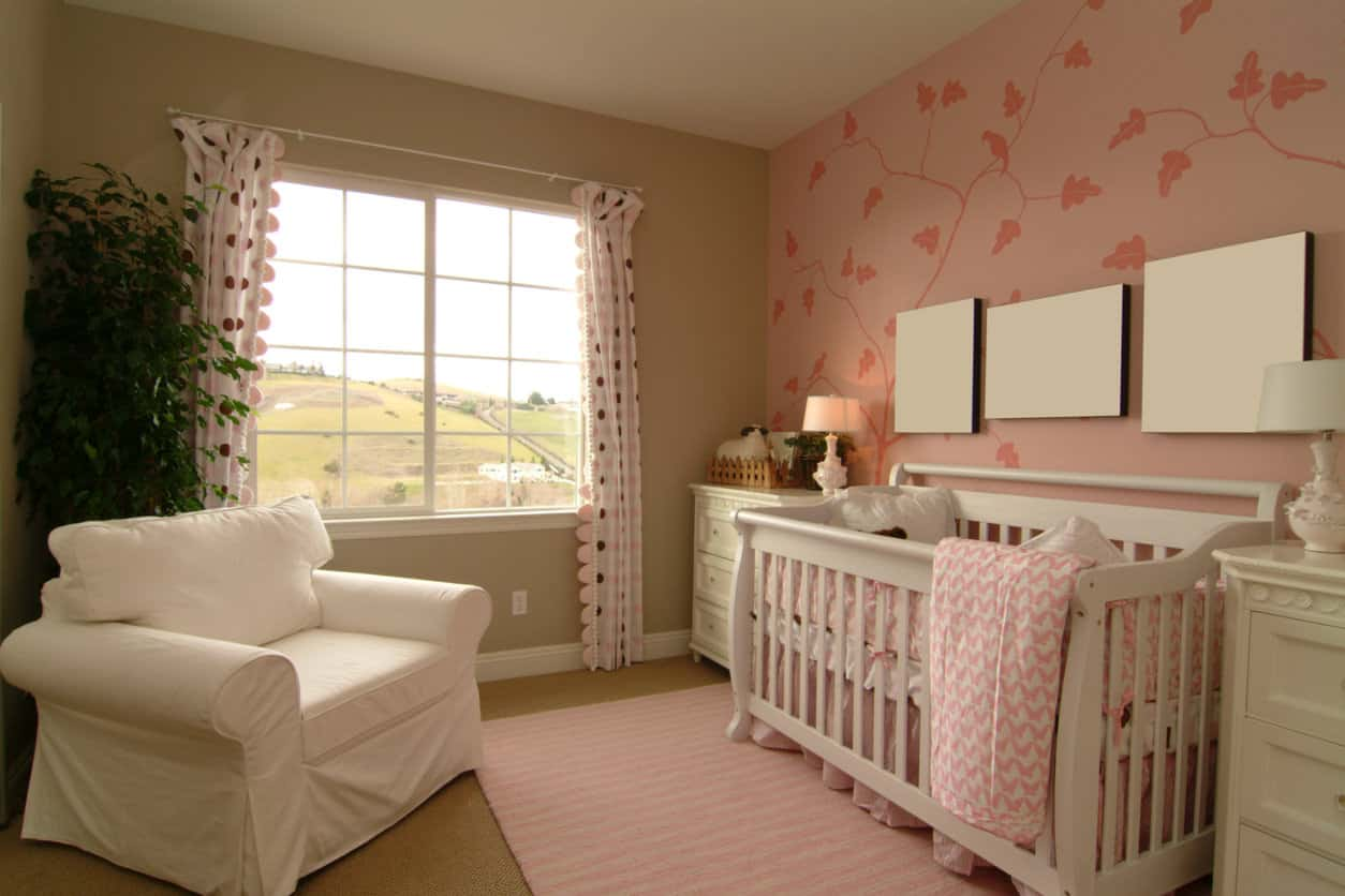 Comfortable baby room in beige and pink.  I think white would be better than beige, but I like curtains and baby furniture.
