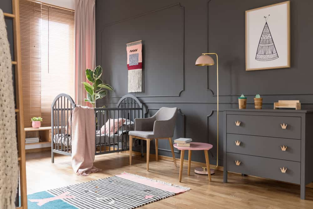 Elegant and large baby nursery in gray and pink.  I don't think that chair will do it though.  When it's in the middle of the night and you need to feed your baby, you need something more comfortable than that.