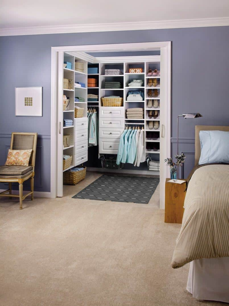 I love this small walk-in closet design with pocket door to save space in both the closet and bedroom.