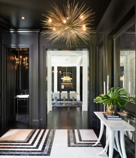 Elegant black foyer with stunning tiles flooring. The walls are just classy while the lighting will make everyone's jaws drop.