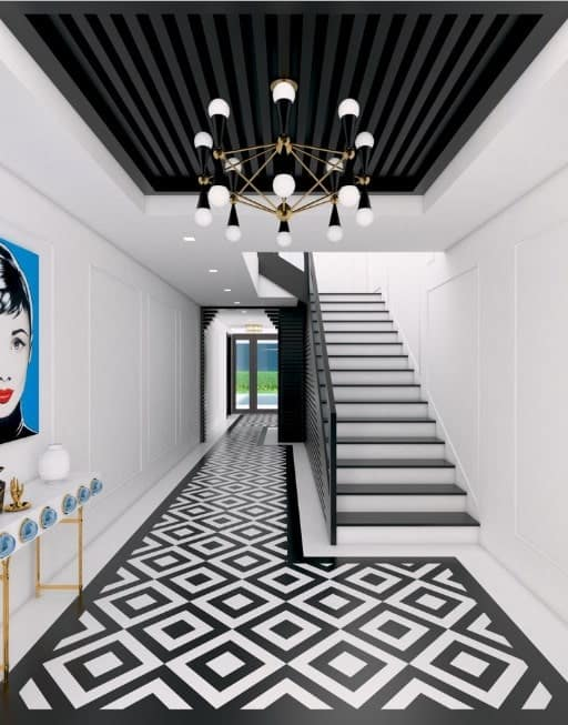 Long foyer featuring a jaw-dropping flooring style. The white walls look beautiful together with the black shade all over the space. The combination of white and black chandelier looks absolutely perfect.