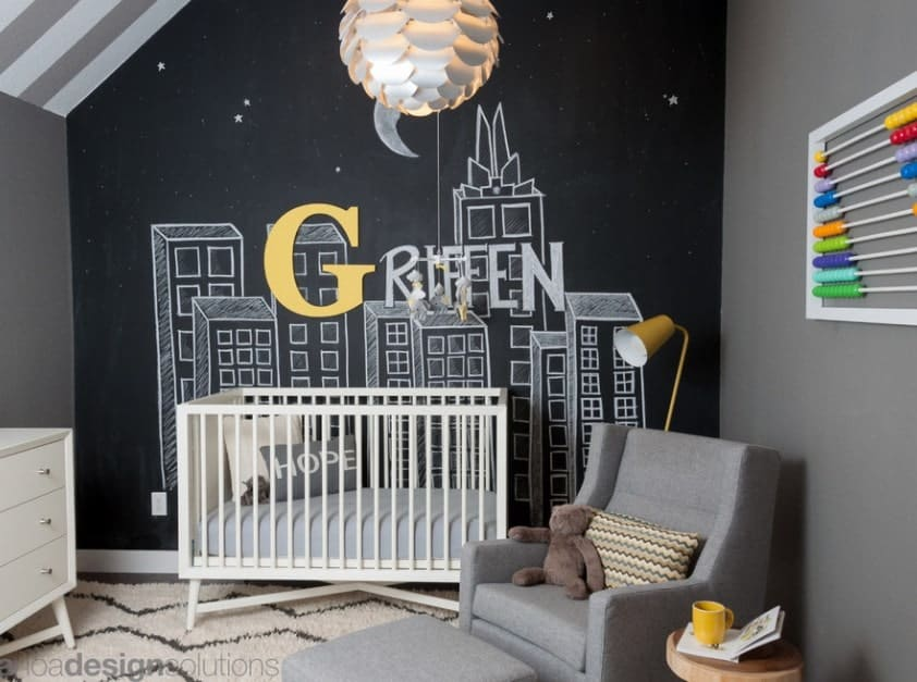 Worried your nursery is too small? Take a page out of this designer's book and use your walls to create 3D drawings that can really open up small spaces while keeping things interesting and unique. The addition of your baby's name can be a great personal touch.