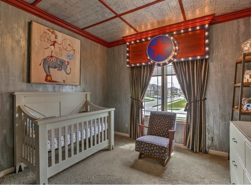 This carnival themed nursery is one of our favorites for the creativity. The nursery is simple and neutral if you look at it but the simple addition of a colorful piece of artwork and the brilliant backlit board over the curtains makes the room instantly unique.
