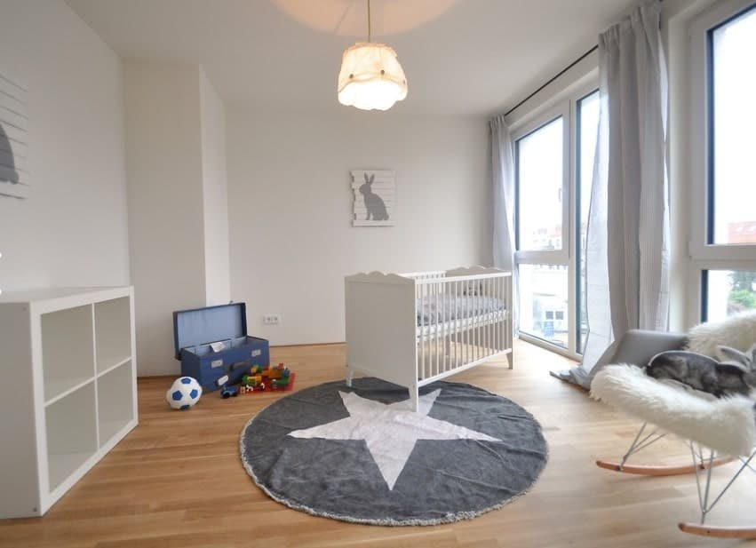 We love the simple, clean design of this nursery. The best part? Plenty of natural sunlight! Don't feel like you have to place your baby's crib up against the wall. Placing it asymmetrically in view of the windows will make sure he gets plenty of Vitamin D and has a great view to look at once he's old enough to stand in his crib.